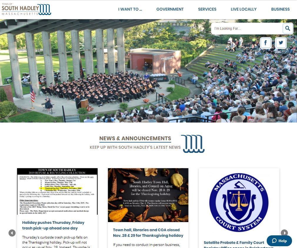 A photo of a graduating class sits in an amphitheater above a town website calendar and news section