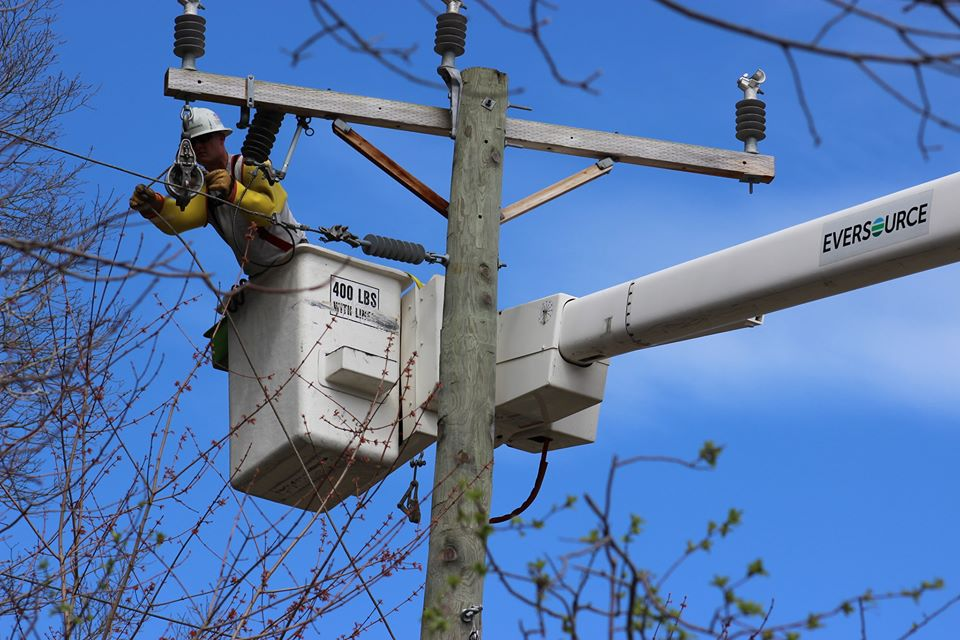 An Eversource lineworker fixes transmission lines