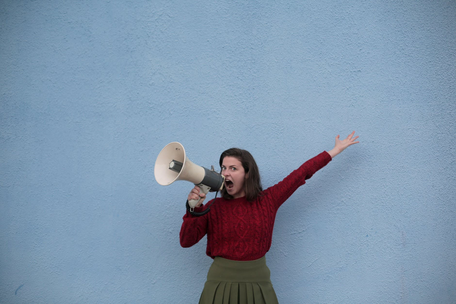 A woman speaks into a megaphone